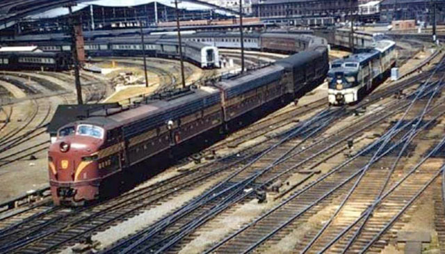 A vintage shot from Fred Ripley, St. Louis, June 1957.  Pennsylvania RR  &quot;Spirit of St. Louis&quot; and Missouri Pacific &quot;Texan&quot;. Track Work! 