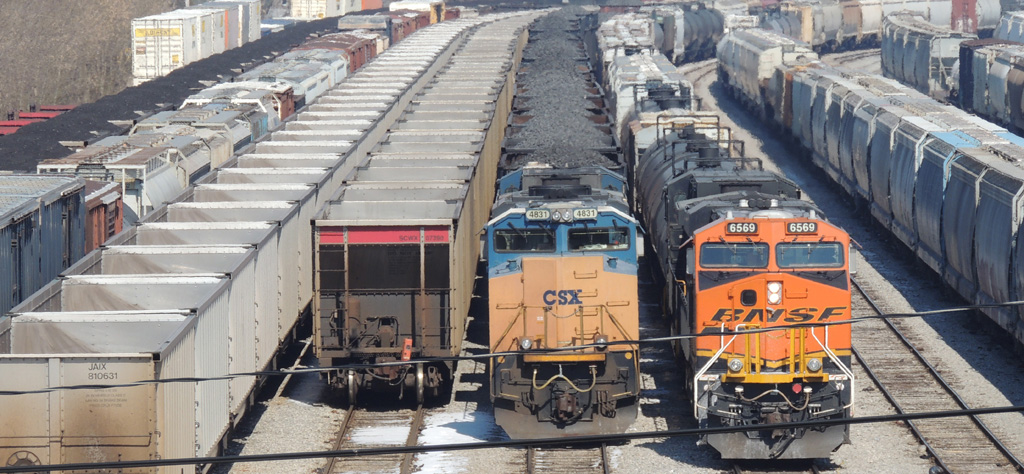 Just another busy day at Howell yard. Two empty coal trains waiting to go back to the mines sit next to two Birmingham bound trains, coke train K325 and Q649 with BNSF and NS power on March 6, 2014 -Thomas Bryan