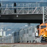BNSF #8179, with special train in tow, passes under one o the signal bridges in San Bernardino CA. Next stop; San Bernardino Amtrak & Metrolink station.