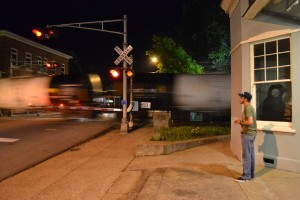 As a northbound train rolls north through Hopkinsville, Thomas Bryan observes outside the former L&N Depot. -Jennifer Brown; Kentucky New Era