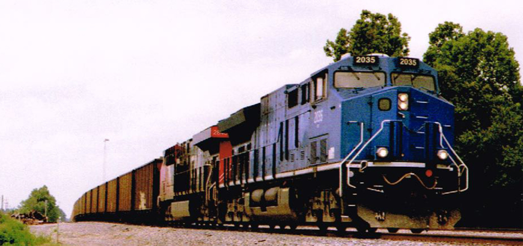 A southbound loaded coal train is led by General Electric's Tier IV Demonstrator locomotive #2035 on a late summer afternoon. - Wallace Henderson