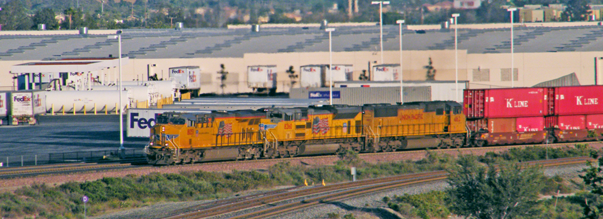 UP ES44AC #8051 leads its stack train, made up primarily of K-Line containers, towards Devore on BNSF trackage. UP's Palmdale cutoff are the tracks in the foreground. - Matt Gentry, 3/28/15