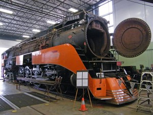 At the Oregon Rail Heritage Center, Southern Pacific GS-4 4449 gets a major overhaul. The big Lima-built 4-8-4 is getting its 15-year boiler inspection, and other needed maintenance is being done concurrently. The work was begun in February 2013 and should be completed in Fall of 2015, with the engine ready for use on the Holiday Express in December 2015. When photographed on August 22, 2015, all flues and tubes had been installed, rolling was done on both ends, welding was done on the flues and tube at the rear flue sheet, and firebox work (including installing new steel at the throatsheet and new circular tubes) was underway. A new superheater unit installation will begin shortly, after which there will be a full hyrdostatic test of the boiler. It will be great to see this old Daylight engine operating again - and when it is done, then work begins on Spokane Portland & Seattle 4-8-4 700!