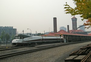 Amtrak Cascades makes a stop at Portland Union Station on Saturday, August 22. If you look close, you can see the rear end of the 4 car Portland segment of Amtrak's Empire Builder. Once it departs, it will head for Spokane to be added to make up the full Empire Builder, along with the Seattle segment, and depart for Chicago. Did you notice the smoke in the sky?