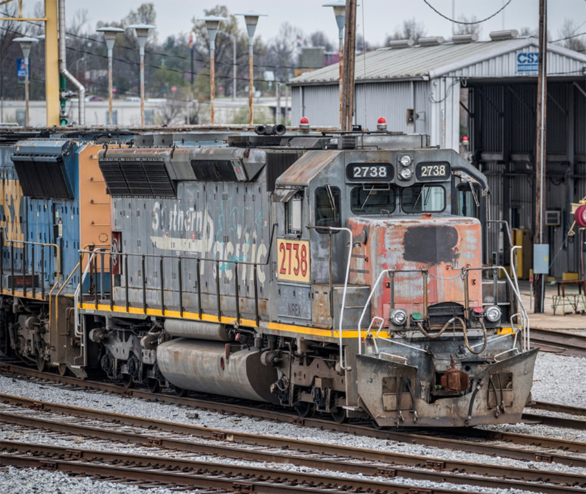 March 30, 2016 - Ex-Southern Pacific, Ex-Union Pacific, NREX 2738 sits at CSX's Atkinson Yard in Madisonville, Ky attached to a string of other power. - Tech Info: 1/640 | f/5.6-6 | ISO 1000/1800 | Lens: Sigma 150-600 @ 280-440mm on a Nikon D800 shot and processed in RAW.  Photo by Jim Pearson