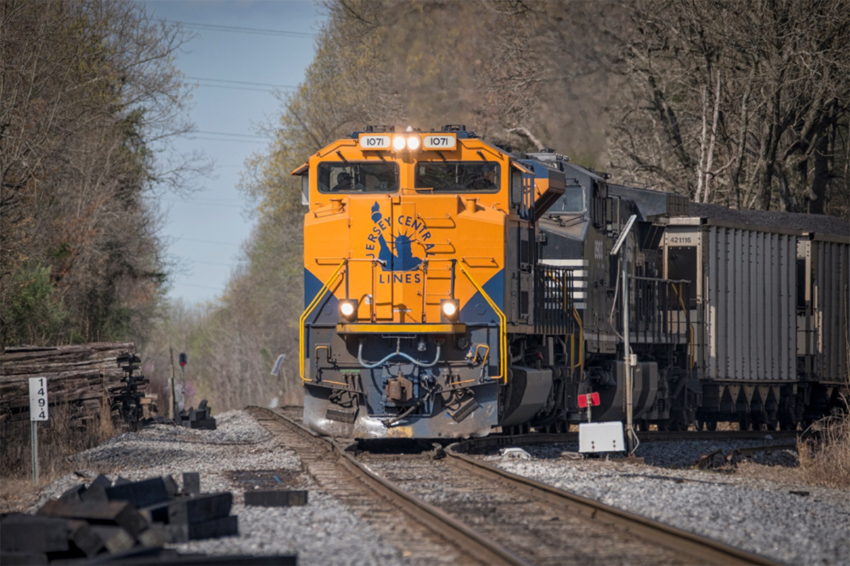 """April 1, 2016 - Norfolk Southern's 1071 Heritage Unit """"Jersey Central Lines"""" pulls out of the Warrior Coal Mine Lead onto Paducah and Louisville Railways Main line at Madisonville, Ky as it begins its northbound trip to Louisville, Ky. The train tied down at Pond River, north of Madisonville till the new crew takes it on north this afternoon around 4pm CST - Tech Info: 1/2500 