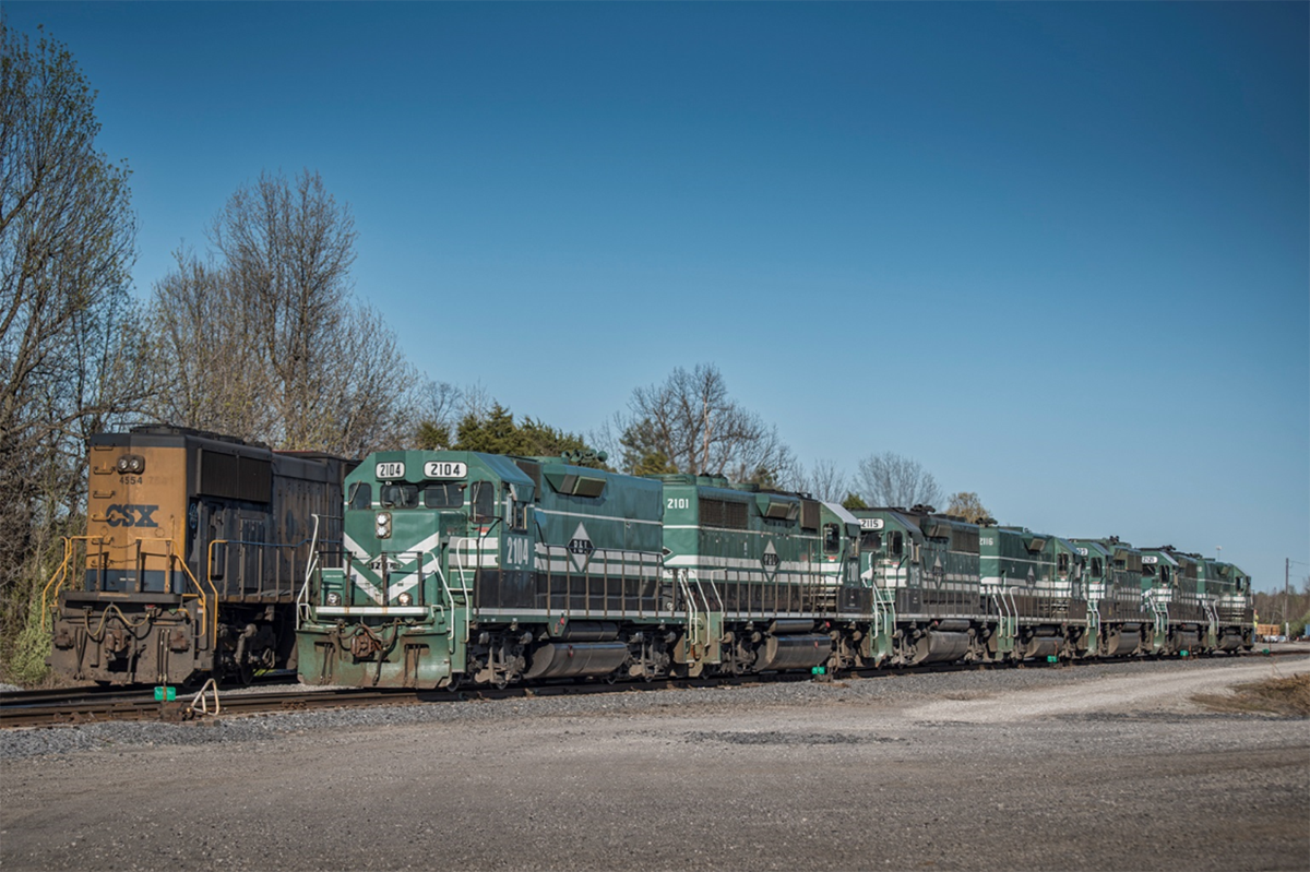April 3, 2016 - Paducah and Louisville Railway 2104 pulls out of the siding at West Yard with 7 units as it works on building a local which had another 2 CSX units and about six cars. Pretty much a power move I'd say! The train headed south toward Paducah. - Tech Info: 1/500 | f/4.5 | ISO 110 | Lens: Nikon 70-300 @ 80mm on a Nikon D800 shot and processed in RAW.  - Photo by Jim Pearson
