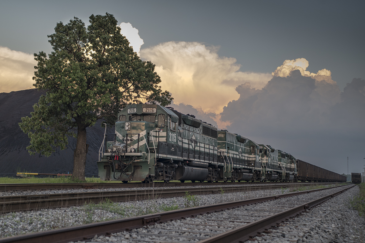 May 10, 2016 - A Paducah & Louisville Railway DPU coal train rounds the loop at the Calvert City Loadout at Calvert City, Kentucky as storm clouds pass in the distance. I think this is the first time I can recall finding a PAL train with DPU units. It had four on the front and four on the rear of the train as it moved through the loop. - Tech Info: 1/1250 | f/5 | ISO 560 | Lens: Sigma 24-70 @ 48mm on a Nikon D800 shot and processed in RAW. - Photo by Jim Pearson