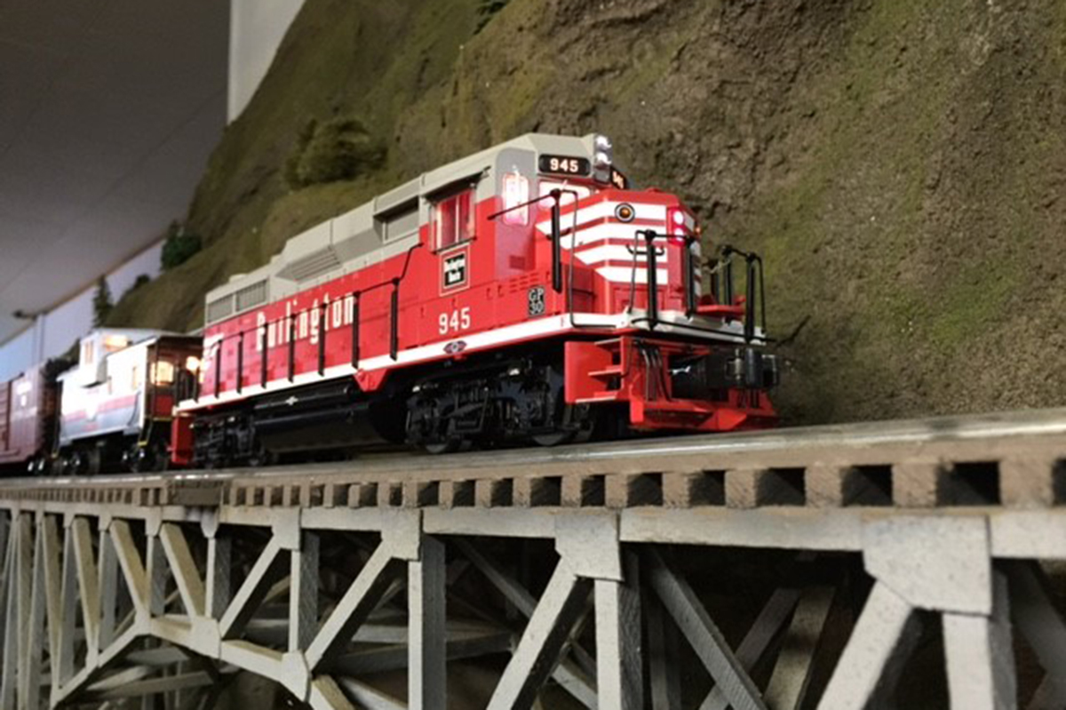 Rich Hane has a fine, Lionel model of EMD's venerable GP-30 and caboose in CB&Q livery. Photographed on the Central & Western Railroad.