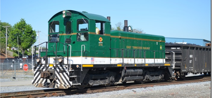 Fred Ripley sent in this photo of more recent ETWNC activity.  East Tennessee Ry. SW-1200 214 switches a metals recycling facility at Johnson City in April 2015.  ETRY is now part of the Genesee & Wyoming family.